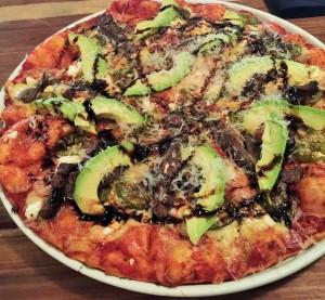 A Kristen pizza with fillet steak, peppadews, avo, feta and balsamic reduction