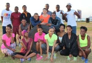Trainers, Lunga Wanda, Kerry-Lee Harrington and Washington Mngomezulu, are surrounded by aspiring models.