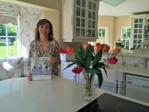 Janet Kohler with her book, Perfect Parties, in her kitchen. It's here that she runs her cooking courses
